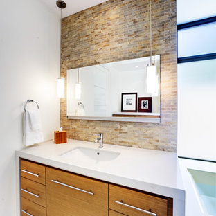 Huge trendy master beige tile, gray tile and porcelain tile porcelain floor alcove shower photo in Orange County with flat-panel cabinets, light wood cabinets, an undermount tub, white walls, an undermount sink and quartz countertops