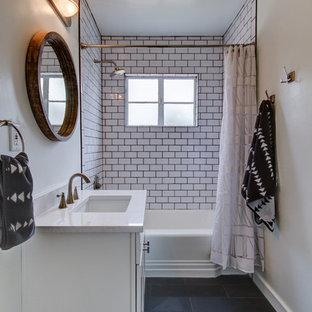 フェニックスの小さいトラディショナルスタイルのおしゃれな子供用バスルーム (シェーカースタイル扉のキャビネット、白いキャビネット、アルコーブ型浴槽、シャワー付き浴槽、白いタイル、サブウェイタイル、グレーの壁、磁器タイルの床、アンダーカウンター洗面器、珪岩の洗面台) の写真