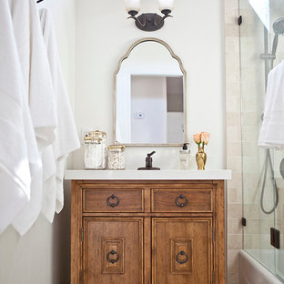 Inspiration for a small mediterranean ensuite bathroom in San Diego with medium wood cabinets, a corner shower, beige tiles, stone tiles, white walls, travertine flooring, a submerged sink, engineered stone worktops, freestanding cabinets and an alcove bath.