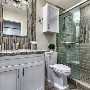 Inspiration for a small transitional 3/4 gray tile and matchstick tile porcelain tile and gray floor bathroom remodel in Phoenix with white cabinets, a two-piece toilet, gray walls, granite countertops, shaker cabinets, an undermount sink and gray countertops