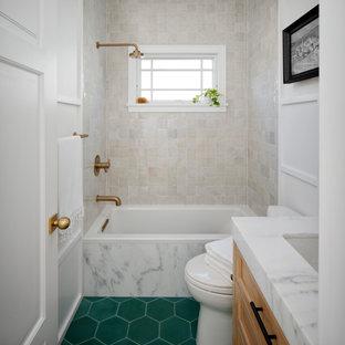 サンフランシスコの小さいトランジショナルスタイルのおしゃれな子供用バスルーム (シェーカースタイル扉のキャビネット、茶色いキャビネット、シャワー付き浴槽、グレーのタイル、セメントタイル、白い壁、セメントタイルの床、アンダーカウンター洗面器、大理石の洗面台、シャワーカーテン、グレーの洗面カウンター、洗面台1つ、独立型洗面台、パネル壁、アルコーブ型浴槽、緑の床) の写真