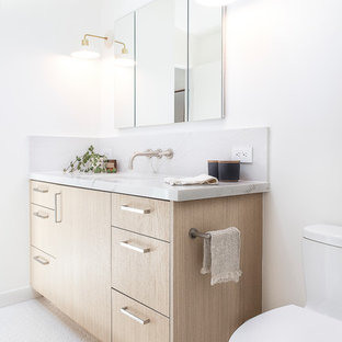 Example of a danish 3/4 mosaic tile floor and white floor bathroom design in San Francisco with flat-panel cabinets, light wood cabinets, white walls and an undermount sink