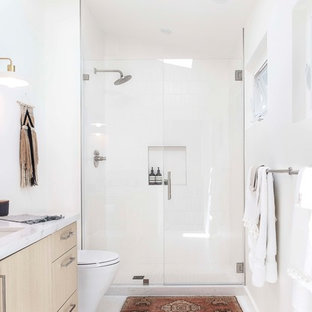 Design ideas for a mid-sized scandinavian 3/4 bathroom in San Francisco with flat-panel cabinets, light wood cabinets, an alcove shower, white tile, subway tile, white walls, mosaic tile floors, an undermount sink, white floor, a hinged shower door, quartzite benchtops and grey benchtops.