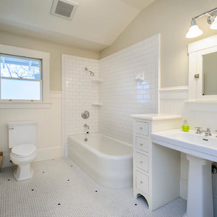 Example of an arts and crafts corner bathtub design in San Francisco with a pedestal sink