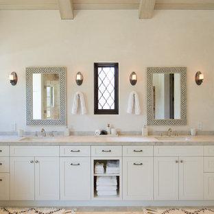 Inspiration for a mediterranean master bathroom in Los Angeles with quartzite benchtops, shaker cabinets, beige cabinets, beige walls, an undermount sink, beige benchtops, limestone floors and beige floor.