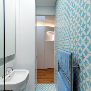 Inspiration for a small contemporary 3/4 blue tile bathroom remodel in Sydney with a console sink and blue walls