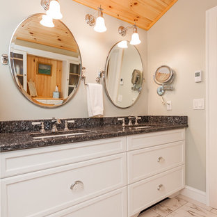 Mid-sized elegant master white tile and porcelain tile bathroom photo in Boston with an undermount sink, recessed-panel cabinets, white cabinets, granite countertops, gray walls and a hinged shower door