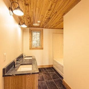 トロントのラスティックスタイルのおしゃれな浴室 (アンダーカウンター洗面器、ソープストーンの洗面台、磁器タイル) の写真