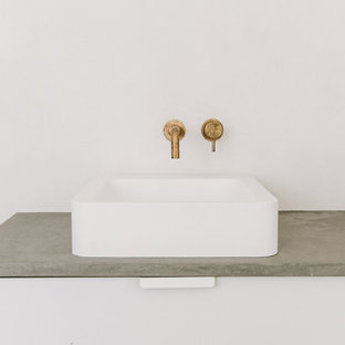 Counter top basin and wall hung brass tap