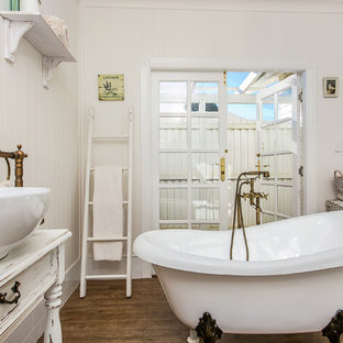 Inspiration for a country master bathroom in Newcastle - Maitland with a claw-foot tub, white walls, a vessel sink and wood benchtops.