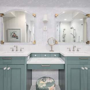 Photo of a transitional master bathroom in Salt Lake City with recessed-panel cabinets, turquoise cabinets, a corner shower, white tile, white walls, an undermount sink, white floor, a hinged shower door and white benchtops.