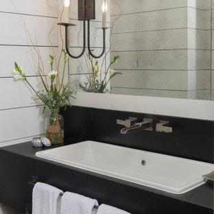На фото: маленькая ванная комната в стиле современная классика с фасадами островного типа, черными фасадами, белыми стенами, накладной раковиной, столешницей из талькохлорита и черной столешницей