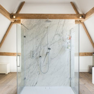 Inspiration for a country master bathroom in Sacramento with a freestanding tub, gray tile, subway tile, white walls, medium hardwood floors, brown floor and a hinged shower door.