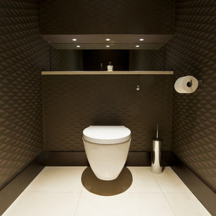 Small trendy porcelain tile bathroom photo in Other with a wall-mount toilet and brown walls
