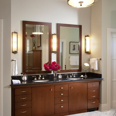Example of a large classic master white tile white floor and marble floor bathroom design in Milwaukee with an undermount sink, flat-panel cabinets, dark wood cabinets, granite countertops and gray walls
