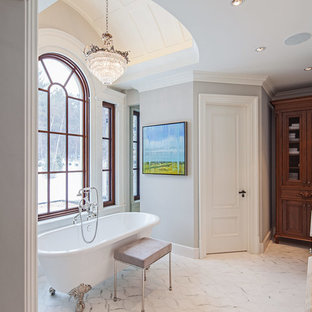 Inspiration for a timeless white tile claw-foot bathtub remodel in Toronto with an undermount sink