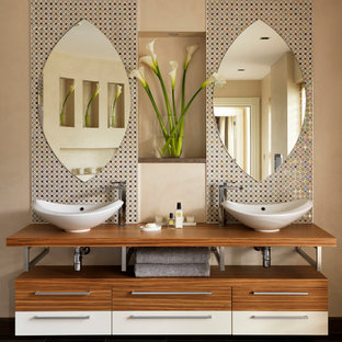 Photo of a large contemporary ensuite bathroom in London with multi-coloured tiles, mosaic tiles, a vessel sink and beige walls.
