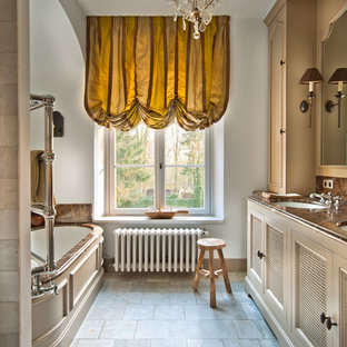 Inspiration for a timeless alcove bathtub remodel in Other with brown countertops
