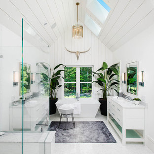 Farmhouse master white floor, shiplap ceiling, shiplap wall and double-sink bathroom photo in New York with furniture-like cabinets, white cabinets, white walls, an undermount sink and white countertops