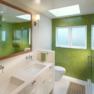 Inspiration for a contemporary bathroom in San Francisco with a submerged sink, flat-panel cabinets, white cabinets, an alcove shower, green tiles, mosaic tiles and green walls.