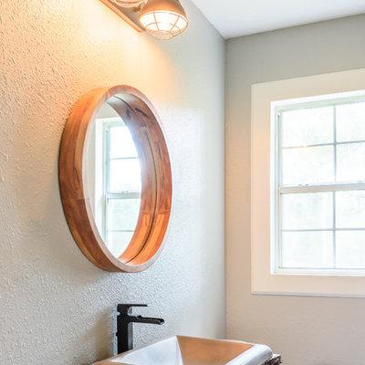 Bathroom - small rustic 3/4 dark wood floor and brown floor bathroom idea in Dallas with a two-piece toilet, gray walls, a drop-in sink, wood countertops and brown countertops