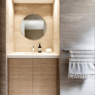 This is an example of a large contemporary 3/4 bathroom in Sydney with light wood cabinets, gray tile, porcelain tile, porcelain floors, an undermount sink, engineered quartz benchtops, grey floor, white benchtops and flat-panel cabinets.