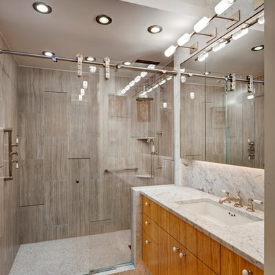 Small trendy gray tile and stone slab bamboo floor alcove shower photo in New York with flat-panel cabinets, light wood cabinets, gray walls, an undermount sink and marble countertops