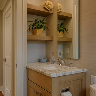 Example of a small arts and crafts beige tile and porcelain tile porcelain tile and beige floor bathroom design in Raleigh with shaker cabinets, medium tone wood cabinets, a two-piece toilet, gray walls, an undermount sink and quartzite countertops