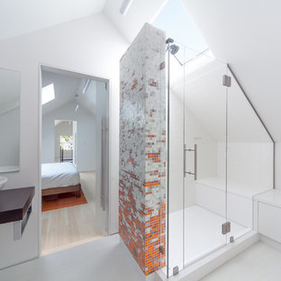 Photo of a contemporary bathroom in Seattle with a vessel sink, multi-coloured tile, mosaic tile and white walls.