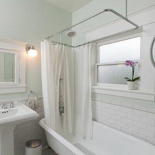 Tub/shower combo - craftsman white tile and subway tile tub/shower combo idea in San Diego with a pedestal sink and white cabinets