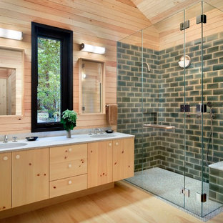 Corner shower - craftsman green tile and subway tile light wood floor corner shower idea in San Francisco with flat-panel cabinets, light wood cabinets, an undermount sink and a hinged shower door