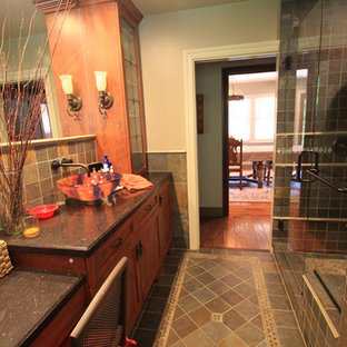 Inspiration for a craftsman multicolored tile and stone tile slate floor alcove shower remodel in Los Angeles with a vessel sink, shaker cabinets, medium tone wood cabinets and quartz countertops