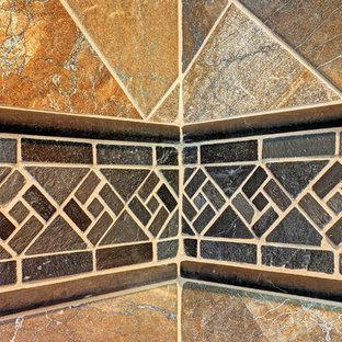 Inspiration for a large craftsman master black tile and porcelain tile walk-in shower remodel in Seattle with multicolored walls