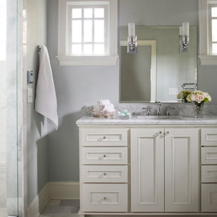 Bathroom - mid-sized traditional master white tile marble floor bathroom idea in Atlanta with an undermount sink, shaker cabinets, white cabinets, marble countertops, a two-piece toilet and blue walls