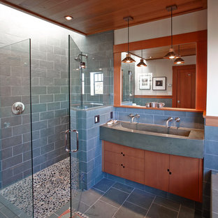 Walk-in shower - mid-sized craftsman master blue tile and stone tile slate floor walk-in shower idea in San Francisco with a trough sink, medium tone wood cabinets, beige walls and flat-panel cabinets