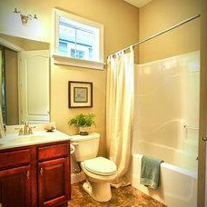 Traditional Bathroom by Landmark Homes