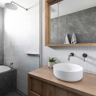 Свежая идея для дизайна: ванная комната в современном стиле с накладной ванной, настольной раковиной, столешницей из дерева, открытым душем, фасадами с утопленной филенкой, фасадами цвета дерева среднего тона, душевой комнатой, белой плиткой, серым полом и коричневой столешницей - отличное фото интерьера