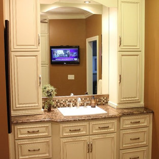 Design ideas for a small 3/4 bathroom in Other with raised-panel cabinets, white cabinets, multi-coloured tile, mosaic tile, orange walls, a drop-in sink, granite benchtops and multi-coloured benchtops.