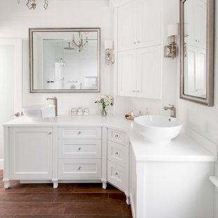 Transitional bathroom photo in Toronto with a vessel sink and white cabinets