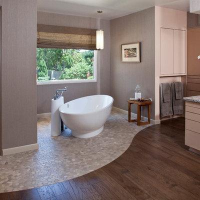 Freestanding bathtub - contemporary pebble tile floor freestanding bathtub idea in Other