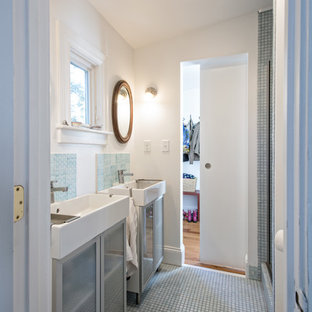 Inspiration for a small traditional ensuite bathroom in Louisville with a console sink, glass-front cabinets, blue tiles, ceramic tiles, white walls and mosaic tile flooring.