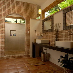 Island style bathroom photo in Houston with a vessel sink, wood countertops and brown countertops