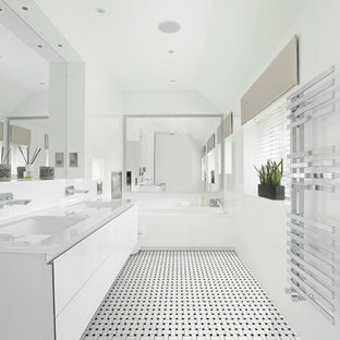 Alcove bathtub - mid-sized contemporary master porcelain tile alcove bathtub idea in Philadelphia with an undermount sink, flat-panel cabinets, white cabinets, white walls, a wall-mount toilet, glass countertops and white countertops