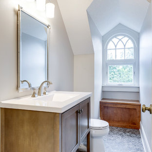 Bathroom - traditional mosaic tile floor and gray floor bathroom idea in Minneapolis with shaker cabinets, medium tone wood cabinets, white walls and a console sink