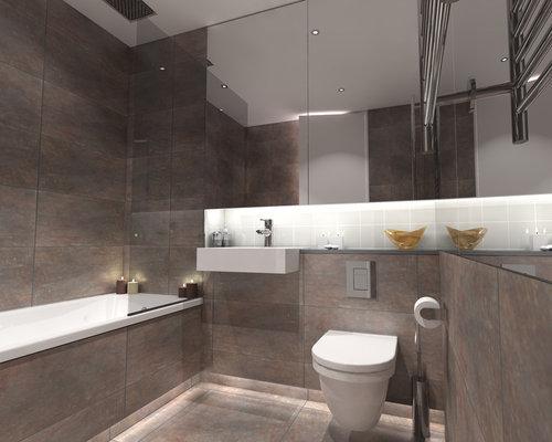 Salle de bain avec un placard porte vitr e et un wc for Placard suspendu salle de bain