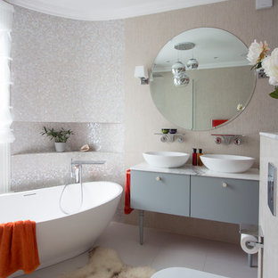 Example of a large trendy master freestanding bathtub design in London