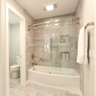 Bathroom - mid-sized transitional master gray tile and marble tile marble floor and white floor bathroom idea in Other with shaker cabinets, white cabinets, a two-piece toilet, gray walls, an undermount sink and quartz countertops