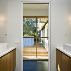 Transitional Bathroom by Arcanum Architecture