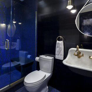 Inspiration for a small contemporary 3/4 bathroom in New York with blue tile, a two-piece toilet, mosaic tile, black walls, mosaic tile floors, an alcove shower, a trough sink, blue floor and a hinged shower door.