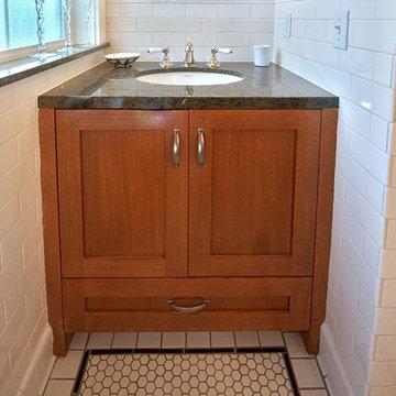 Custom built-in white oak vanity with granite countertop